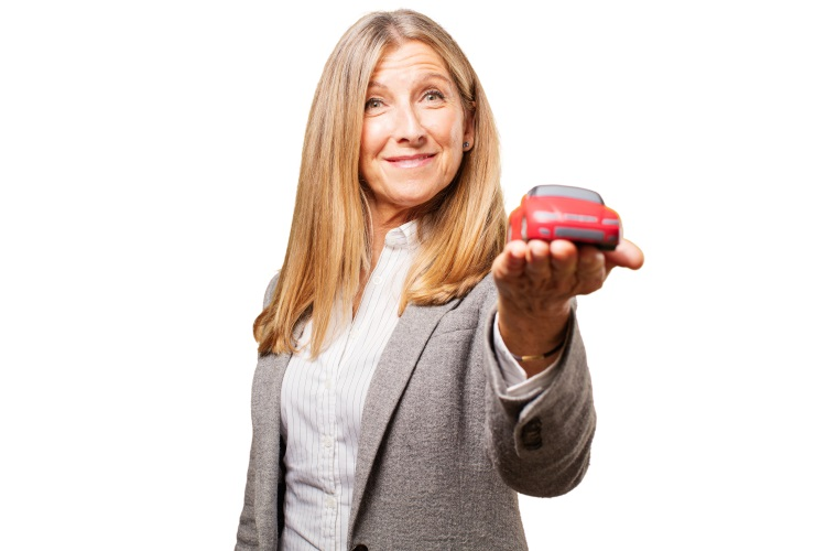 senior beautiful woman with car toy